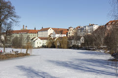 Colorful royal snowy medieval Town Pisek above the frozen river Otava, Czech Republic Royalty Free Stock Image