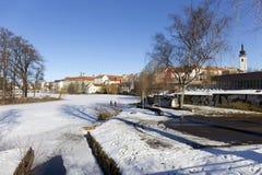 Colorful royal snowy medieval Town Pisek above the frozen river Otava, Czech Republic Stock Images