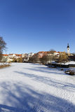 Colorful royal snowy medieval Town Pisek above the frozen river Otava, Czech Republic Royalty Free Stock Photo