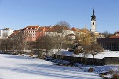 Colorful royal snowy medieval Town Pisek above the frozen river Otava, Czech Republic Stock Image