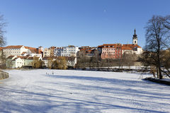 Colorful royal snowy medieval Town Pisek above the frozen river Otava, Czech Republic Royalty Free Stock Photography