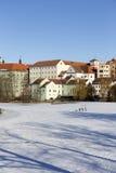 Colorful royal snowy medieval Town Pisek above the frozen river Otava, Czech Republic Stock Photos