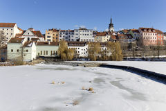 Colorful royal snowy medieval Town Pisek above the frozen river Otava, Czech Republic Royalty Free Stock Photos
