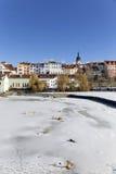 Colorful royal snowy medieval Town Pisek above the frozen river Otava, Czech Republic Stock Photo