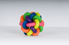 Colorful rubber ball. A colorful bouncing ball for kids made from strips of colored rubber/plastic compound Royalty Free Stock Photo