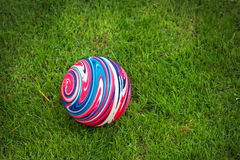 Colorful rubber ball on the grass. Colorful rubber ball on the green grass Stock Photography