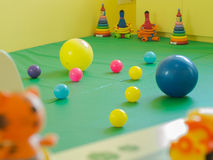 Colorful rubber ball. In kindergarten room Royalty Free Stock Photo