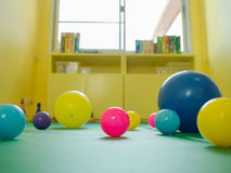 Colorful rubber ball. In kindergarten room Royalty Free Stock Photos