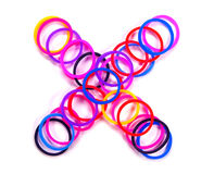 Colorful rubber band multiply symbol. Royalty Free Stock Photo