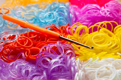 Colorful rubber bands and a hook tool Stock Image