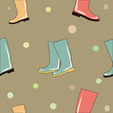 Colorful rubber boots seamless background vector Stock Images