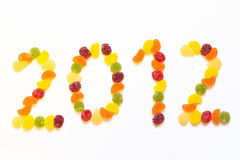 Colorful rubber candies arranged in digits. Colorful rubber candy digits arranged in 2012 for forming a white background Royalty Free Stock Images