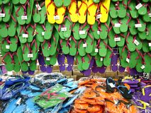 Colorful rubber slippers or flipflops on display at a supermarket Stock Photo