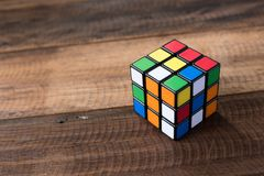 Colorful rubik`s cube on a wooden table background Royalty Free Stock Photos