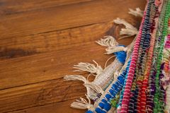Colorful rug on wooden background stock images