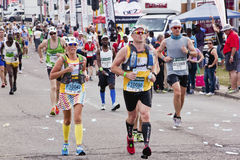 Colorful Runners Participate in Comrades Marathon Royalty Free Stock Photo