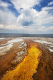 Colorful runoff from Black Pool leads to Yellowstone Lake Stock Photography