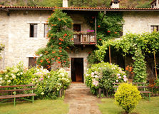 Colorful rural house with garden Stock Photo
