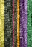 Colorful rustic linen fabric background. Texture of a rustic linen fabric with colorful stripes stock photos