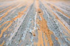 Colorful rusty metal. Close up perspective of rusty metal factory wall in yellow, grey and blue Royalty Free Stock Photography