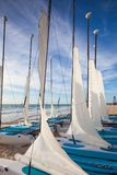 Colorful sail catamarans on the beach at Caribbean Sea of Mexico. Playa Paraiso, Mexico - February 4, 2018: Colorful sail catamarans on the beach at Caribbean Royalty Free Stock Image