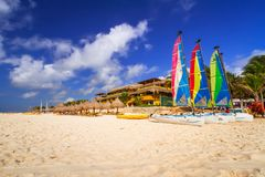 Colorful sail catamarans on the beach. PLAYA DEL CARMEN, MEXICO - JULY 11, 2011: Colorful sail catamarans on the beach of Playacar at Caribbean Sea of Mexico Royalty Free Stock Photo