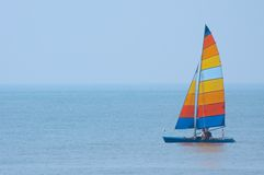 Colorful Catamaran with Striped Sails Royalty Free Stock Photography