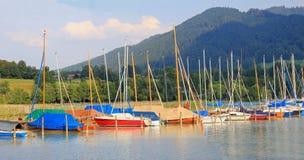 Colorful sailboats at the lakeside of tegernsee Royalty Free Stock Photos