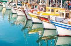 Colorful sailing boats at Fishermans Wharf of San Francisco Bay