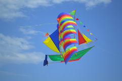 Colorful sailing ship kite soaring in the sky Stock Images