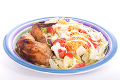 Colorful salad with chicken thigh and wing on the side Stock Photography
