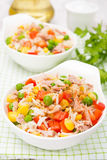 Colorful salad with corn, green peas, rice, red pepper, tuna Royalty Free Stock Photos
