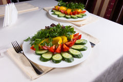 Colorful Salads on Restaurant Table. Two Colorful Salads at Place Settings on Restaurant Table stock image