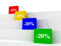 Colorful sale bags with discount signs Stock Photos