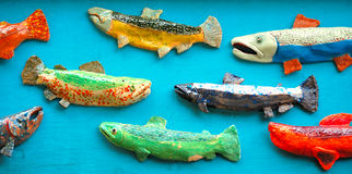 Colorful Salmon Art. Photograph of colorful salmon artwork on blue background Stock Image