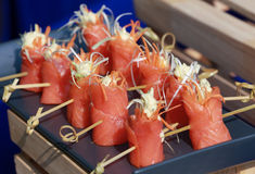 Colorful salmon canapes. On a blue tray Stock Photos
