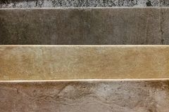 Colorful samples of granite and ceramic tiles displayed in shop close up royalty free stock images