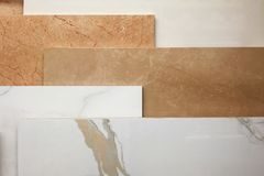 Colorful samples of marble and ceramic tiles displayed in shop close up royalty free stock photography