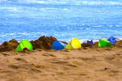 Colorful Sand buckets Stock Photos