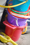 Colorful sand pails at the beach Stock Image