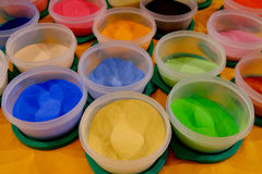 Colorful Sand Powders for Art. Containers of finely colored sand powders used by Tibetan Tantric Buddhist monks to create a sand mandala Stock Photos