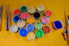 Colorful Sand Powders and Tools for Sandpainting Art. Containers of finely colored sand powders used by Tibetan Tantric Buddhist monks to create a sand mandala Stock Images