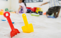 Colorful sand shovel toy with children. Stock Photography