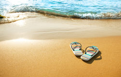 Colorful sandals on beach Stock Photography