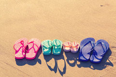 Colorful sandals at the beach Royalty Free Stock Images