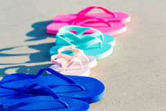 Colorful sandals at the beach Royalty Free Stock Photos