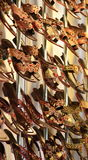 Colorful sandals on rack. Closeup of fashionable sandals on display rack in shop or store Royalty Free Stock Photography