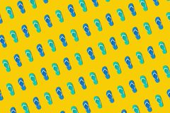 Colorful sandals in seamless photo on yellow background.design for holiday and summer concepts royalty free stock photography