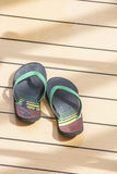 Colorful Sandals on Wood Deck Royalty Free Stock Photos