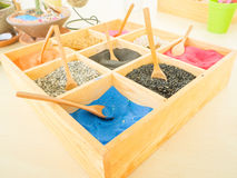 Colorful sands and rocks in wooden box Stock Photography